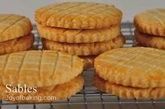 Sables (French Butter Cookies) Tested Recipe with unsalted butter, granulated white sugar, large eggs, pure vanilla extract, all-purpose flour, baking powder, salt, large eggs, water