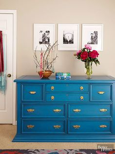 Would you believe this chic blue dresser used to be a kitschy knotty pine? This technique can cover up a finish that doesn't flow with your look. Paint the dresser in a rich color, then apply a glaze to the corners for a lightly distressed look. Brass hardware completes the makeover. /