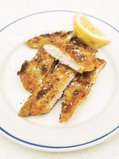crunchy garlic chicken | Jamie Oliver 1 clove garlic 1 lemon 6 saltine crackers 2 tablespoons butter 4 sprigs of fresh Italian parsley sea salt freshly ground black pepper 2 heaped tablespoons all-purpose flour 1 large free-range egg 2 skinless higher-welfare chicken breast fillets olive oil