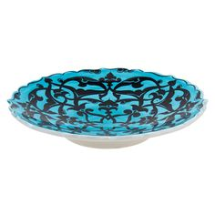 "Inspired by our ""Court and Cosmos: The Great Age of the Seljuqs"" exhibition this handmade iznik Turkish Interlaced Foliage Plate uses motifs and techniques dating back to ancient times. This modern palette of black and turquoise feels modern but actually dates back to the 12th century."