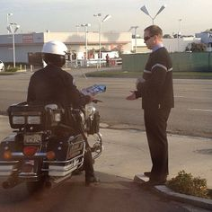 Torrence, California USA - Sharing the Good News with a police officer. www.jw.org -- Photo shared by @rhyce_cake