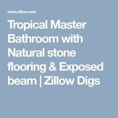 Tropical Master Bathroom with Natural stone flooring & Exposed beam | Zillow Digs