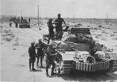 A column of Panzer 3 tanks operating with Afrika Korps forces in the Lybian Desert
