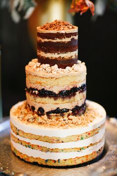 A wedding cake we can't wait to devour! Photography By / aprylann.com, Floral Design By / bowsandarrowsflowers.com