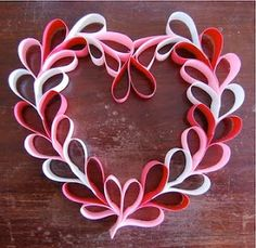 A Valentine's Day Door wreath - simple and pretty.  They would look very nice on the doors of the seniors' rooms in February.  Let's use card stock so it holds the shape better.