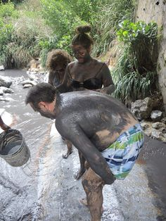 Taking a mud bath in St Lucia on an active afternoon of travel on the island.