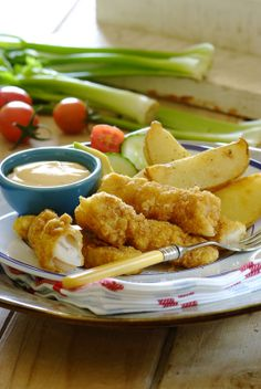 Crispy Home-Made Fish Fingers with potato wedges and salad  #recipes #fish #seafood #SouthAfrican