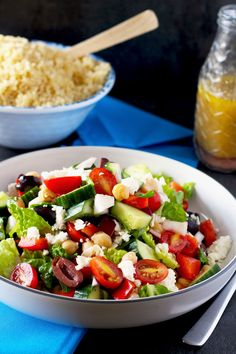 The Ultimate Greek Chopped Salad, a quick, easy and healthy salad with tomatoes, cucumbers, red onions, garbanzo beans, Kalamata olives and Feta cheese tossed in a simple red wine-oregano vinaigrette