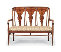 'SUNLFLOWERS' A LOUIS MAJORELLE MARQUETRY AND CARVED SETTEE -  CIRCA 1900