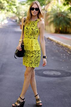 Shop this look on Lookastic:  http://lookastic.com/women/looks/sheath-dress-crossbody-bag-bracelet-bracelet-sunglasses-wedge-sandals/5516  — Yellow Lace Sheath Dress  — Black Leather Crossbody Bag  — Black and Gold Leather Bracelet  — Gold Bracelet  — Black Sunglasses  — Black and Gold Studded Suede Wedge Sandals