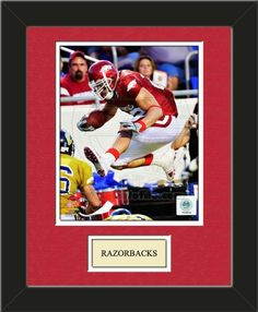 One framed 8 x 10 inch University of Arkansas photo ofPeyton Hillis Aarkansas Razorbackswith a customizable nameplate*, double matted in team colors to 11 x 14 inches. $49.99         @ ArtandMore.com