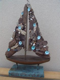 Driftwood boat with shells