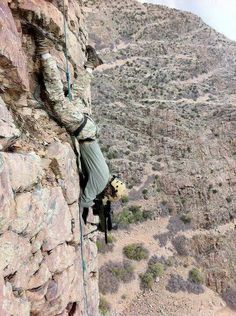 Death from above.... Sniper hanging off the side of a mountain... Badass!!!