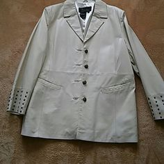 Leather Jacket In mint condition, butter cream colored leather jacket. Antique brass  colored buttons and studs on sleeves. No back pleat and front pockets with studs on flap that can go in pocket or out as shown in pics 3-4. Fully lined. Terry Lewis Jackets & Coats Blazers