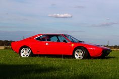 Ferrari Dino 308 GT4. Hi! I'm a little red car that will drive you around! Vrrrrooom.