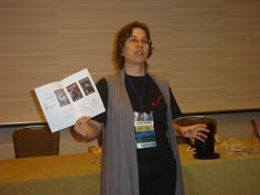 Author Lynda Williams showing off ORU Art Book by Michelle Milburn at Chicon 7, Sept 2012.