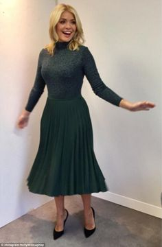 Holly Willoughby, has been rocking a new look after swapping her figure-hugging outfits for floaty midi skirts and jumpers, but some critics have branded the makeover 'frumpy' and 'dreadful'. Stylish Girl, Stylish Outfits, Stylish Clothes, Holly Willoughby Outfits, Green Pleated Skirt, Pleated Skirts, Midi Skirt, Matches Fashion, Office Outfits