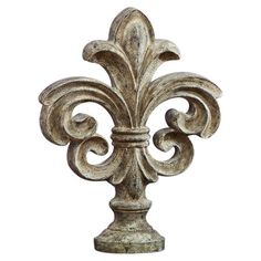 This weathered fleur-de-lis decor adds and artisan-inspired touch to your mantel or bookshelf. Product: DecorConst...