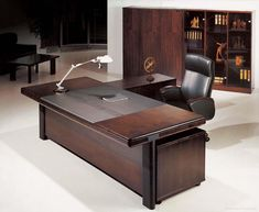 Office & Workspace,Dazzling Dark Brown Wood Executive Office Desk Design Ideas With Cool Black Arm Chair And Modern Stand Lamp Also Antique Dark Brown Wood Bookcase,Comfort Workspace With Exetucutive Office Desks