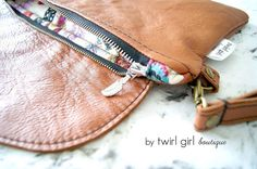 These are the perfect clutch Zip!! From @boodesigns ... a silver feather pull.. to match the fabric... ahhhh... 😊 . #twirlgirlboutique #twirlgirlboutiquecustomorder #boodesignszip #twirlgirlboutique boozip #tanleather #panicclutch #handmadeinmelbourne #ilovehandmade