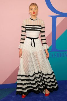 Elsa Hosk attends the CFDA Awards wearing a white lace gown with black micro ruffles from the  Philosphy di Lorenzo Serafini