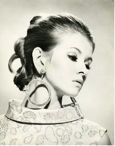 Martha Stewart, fashion model. You HAVE to love the fake lashes and huge, bejeweled circle earrings.