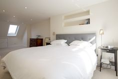 Spacious Loft conversion in East London from Simply Loft. We love the recessed shelving!