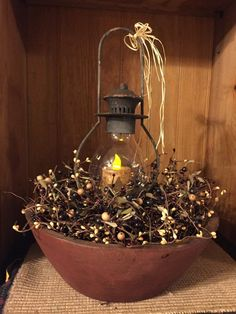 This beautiful arrangement features a primitive, rustic lantern with a battery operated, timer candle. The lantern is accented with a raffia bow. The arrangement measures 19 Primitive Homes, Country Primitive, Primitive Kitchen, Primitive Crafts, Primitive Antiques, Primitive Bedroom, Primitive Snowmen, Prim Decor, Rustic Decor