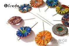 Broche realizado con reciclado de cd,cable,hilo, cobre y alpaca