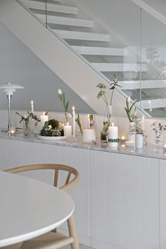 A nice alternative way to decorate for Christmas is to gather lots of different candles and vases with flowers