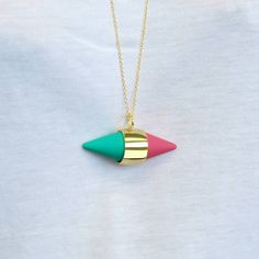 Apple And Raspberry Geometric Capsule Necklace - Bright, bold and in vogue, this stunning gold capsule necklace looks wonderful layered with other designs.  The contemporary design along with its sugary pink and icy pistachio hues really make it stand out from the crowd! #Jasperandopal #Jewellery #Valentine #Valentinesday #PersonalisedGift #ForHer