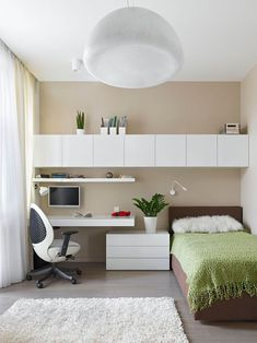 Teen guest bedroom office study row of wall cabinet storage over bed desk