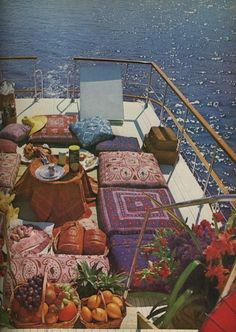"Houseboat luxury on the sun deck: ""Houseboating with the Tunney's"", photos by David Massey from Vogue UK, January 1972."