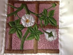 Sample of machine embroidery on painted background by Margaret Roberts.