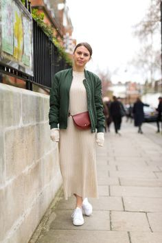 60 fall outfit ideas to start wearing now: a midi dress, green bomber jacket and white sneakers