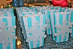 Cute popcorn cups at a Winter Wonderland party!  See more party ideas at CatchMyParty.com!  #partyideas #winter