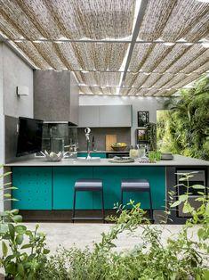 Cozinha integrada com o jardim para descontrair