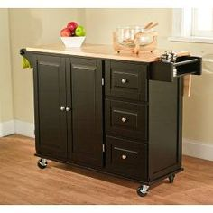 If you like to have your kitchen implements handy this black wooden kitchen cart would suit your needs. Featuring storage shelves, three drawers, a towel rail, and a spice rack, this wheeled cart with drop-leaf top can be placed wherever you need it. Drop Leaf Kitchen Island, Rolling Kitchen Island, Kitchen Island Table, Kitchen Dining, Door Storage, Storage Cabinets, Storage Drawers, Storage Shelves, Drawer Spice Rack