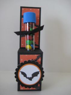 Make batty paper on the Imagine.The polka dot orange is from Bubblegum Stripes.  Cricut Craft Room to place bats from Happy Hauntings onto the pattern paper.  Scalloped circle from Easter 2010 and a circle punch for the others.
