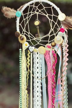 Dream catcher. Cute and easy to make. Love the key in the middle but can use other charms too.