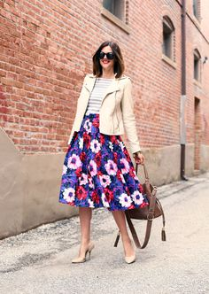I would never think to pair the bold flower pattern with stripes but she looks darling! That skirt is gorgeous.