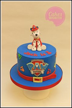 Paw patrol birthday cake with edible Marshall cake topper.