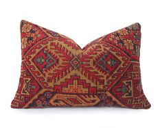 Heres an earthy colored pillow cover in brick / rust red, gold tan, black and turquoise that will add color, graphic and textural interest to