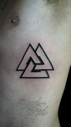 Awesome Black Triangle Tattoo On Man Left Side Rib