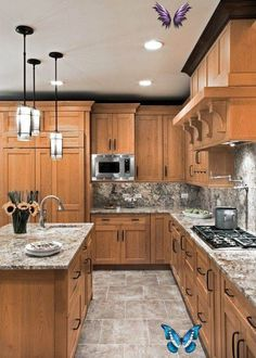 Love the countertops, the pendant lights, and the color of the cabinets.  IMHO, white is not a good cabinet choice, because if you cook a lot, they look dirty too quickly.  I think that the backsplash needs to be a different color, something darker, to jazz it up a bit.<br>