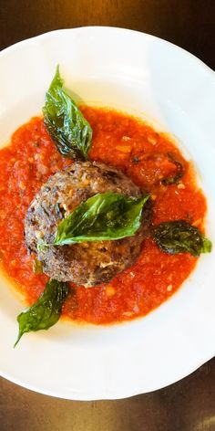 Polpettone | Explore this incredible meatball dish from Giovanni's Italian, crafted with bococini, beef, veal, and pork over a glazed pomodoro sauce.