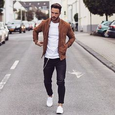 Picture Of navy jeans, a white tee, an amber leather jacket and white chucks (great casual work outfit)