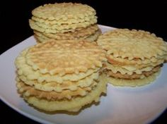 Gluten Free Pizzelles   FaveHealthyRecipes.com This is a family tradition of ours. The women make the dough and the men press the cookies. I'm not sure why, but we've always done it this way. I'll try this dough for Jeran this year so he can enjoy the cookies he makes.