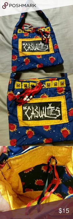 """Kids Handmade Casualties punk shoulder bag, purse *Great for that little girl that wants to be like her punk rock mommy! *great for dress up  *Flaming skulls fabric, crust punk band The Casualties high quality patch, pyramid studs,  and an inner pocket  *10"""" wide, 9.5"""" tall, 9"""" drop from top of bag to top of shoulder strap *ribbons closure *sturdy fabric with quilt batting lining, resembling vera Bradley   Hot topic, punk, crust, handbag, pocketbook, purse, tote, the addicts, crass,  kids…"""