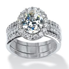Set yourself apart in this stunning three piece set. 3.72 carats T.W. of oval and round cz's in the popular halo. Platin-6HhnwH0Q